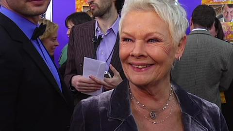 Dame Judi Dench Brands Us 'Sly' on the Red Carpet