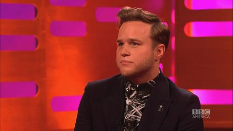Jennifer Aniston Presents Olly Murs with 'Rear of the Y...